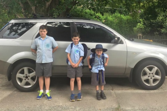 kids in front of car